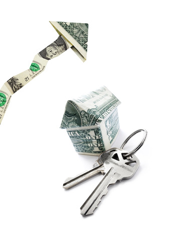 house prices: House keys and dollar house, with up arrow isolated on white   -- housing prices concept