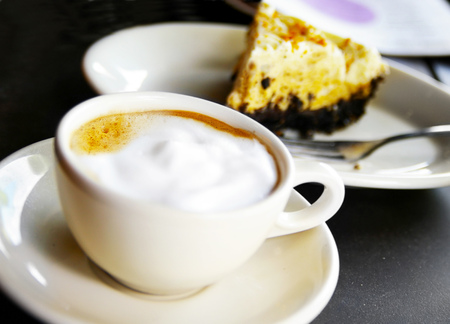 cappuccino cup: cup of cappuccino and chocolate cream pie