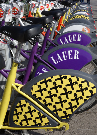 Vienna, Austria - 9-23-2016: Assorted bike-share rental bicycles parked in Vienna Austria