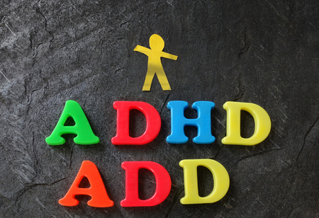 ADD (Attention Deficit Disorder) and ADHD spelled out in play letters, with paper child cutout