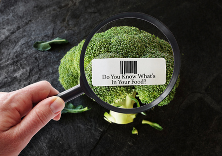 Person examining UPC food label -- healthy food or safety concept