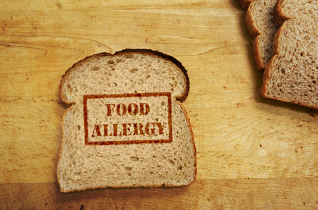 Slice of bread with Food Allergy text Imagens