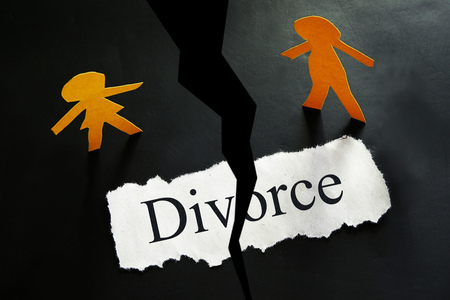 torn Divorce paper with paper cutout couple Stock Photo
