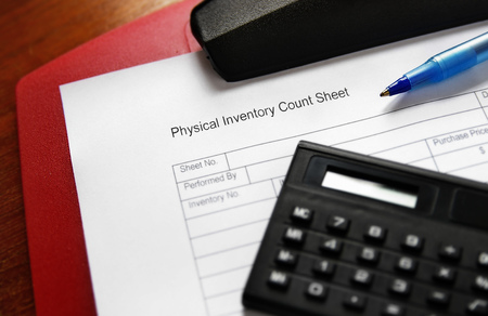 Business inventory sheet and clipboard