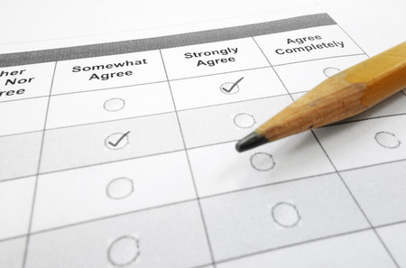 Survey questionnaire or customer satisfaction form and pencil
