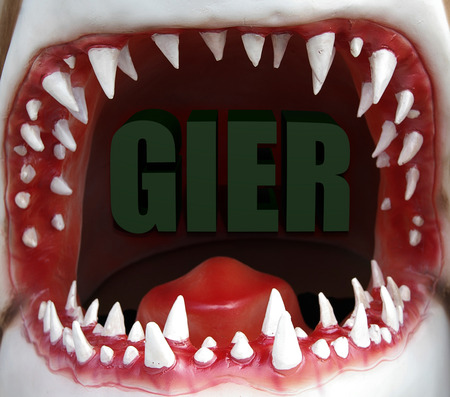 open shark mouth with Gier (Greed) text Zdjęcie Seryjne