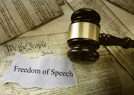Freedom of Speech message on US Constitution with court gavel -- First Amendment concept