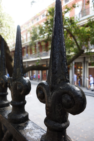 New Orleans French Quarter street and fleur de lis fence Stock Photo