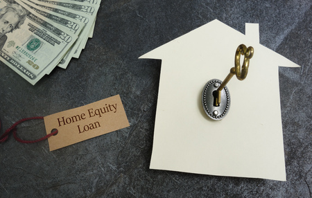 Home Equity Loan tag with paper house, key and cash