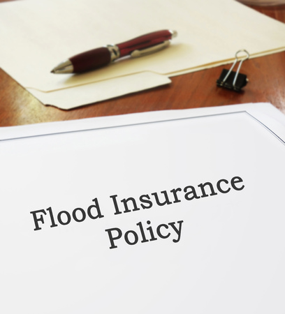 Flood Insurance Policy on an office desk Stock fotó