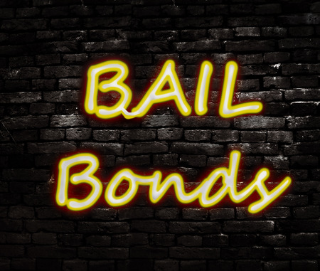 Neon Bail Bond sign on a brick wall