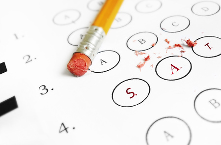 SAT college admissions test and pencil eraser Imagens