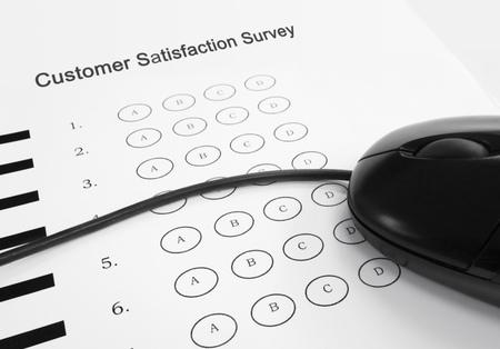 Customer Satisfaction Survey and computer mouse Zdjęcie Seryjne