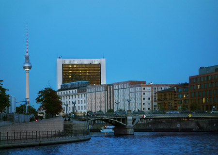 View of the Berlin skyline with the Spree River in the foreground and the radio tower in the distance