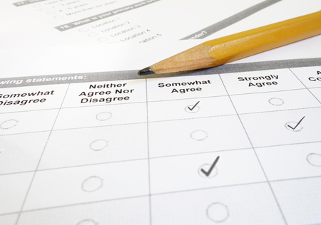Customer satisfaction survey or employee questionnaire and pencil