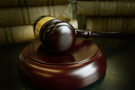 Judges legal gavel and old law books