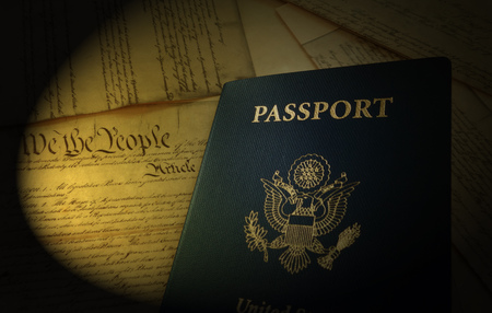 US passport on pages of the United States Constitution