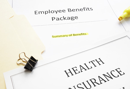 Employee Benefits package (summary of benefits) and health insurance document Stock Photo