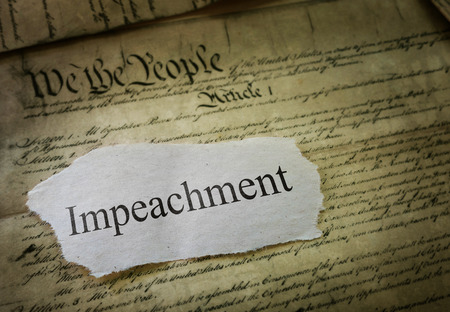 Impeachment news headline on a copy of the United States Constitution                                Imagens