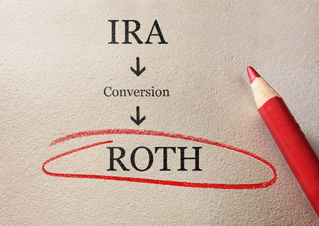 Traditional IRA to Roth IRA conversion concept, circled in red pencil Foto de archivo