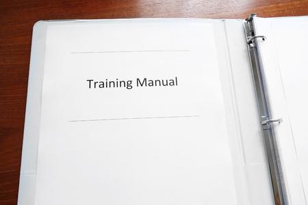 Employee Training manual on a desk Stock Photo