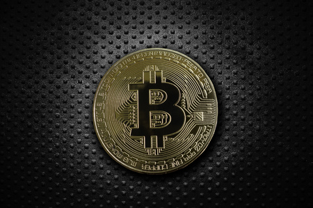 Gold bitcoin on grunge rivet metal background