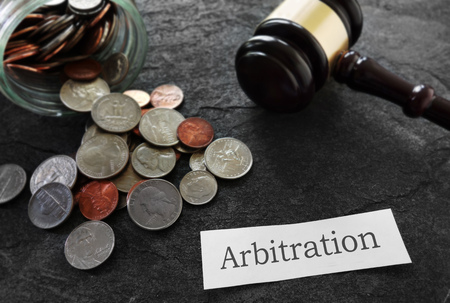 Coins and legal gavel with Arbitration news headline                                Stock Photo
