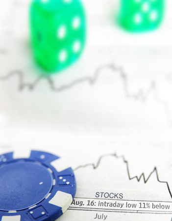 Blue chip and stock market graph with dice