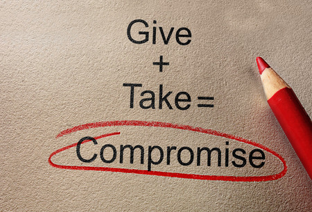 Give and Take Compromise text on paper with pencil