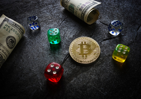 Bitcoin with colored dice and money