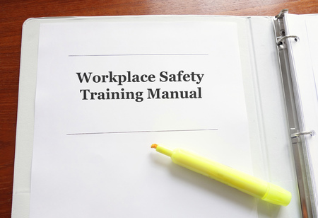 Employee Workplace Safety Training Manual on a desk with highlighter Reklamní fotografie - 92705015