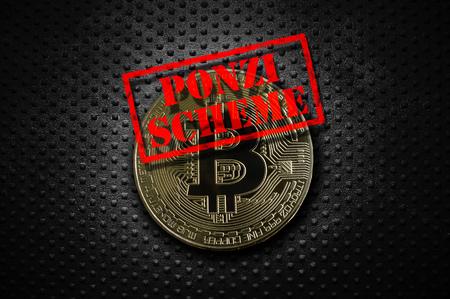 Gold bitcoin with Ponzi Scheme stamp, on grunge rivet metal background Foto de archivo