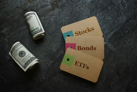 ETF (Exchange Traded Funds), Stocks and Bonds paper tags with money