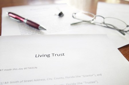 A Living Trust legal document on a desk