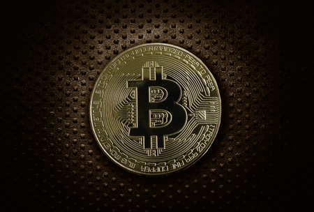 Gold bitcoin on industrial grunge metal background
