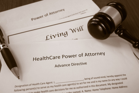 Healthcare Power of Attorney, Living Will documents with legal gavel