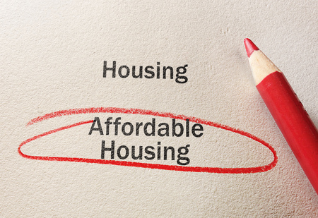 Affordable Housing text circled in red pencil, on textured paper Imagens