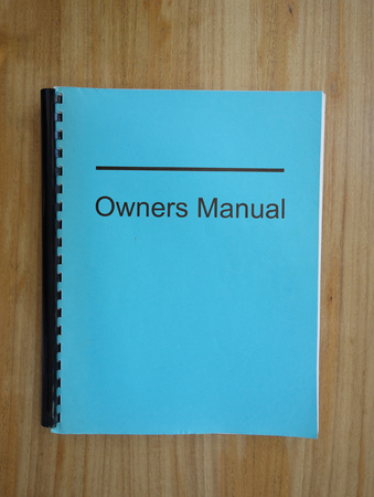 Owners manual binder on a desk