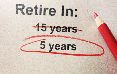 Red pencil circle around 5 years retirement text -- early retirement concept