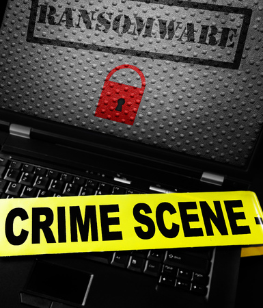 Ransomware and lock on a laptop screen with crime scene tape