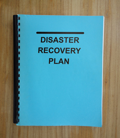 Disaster Recovery Plan document on a desk