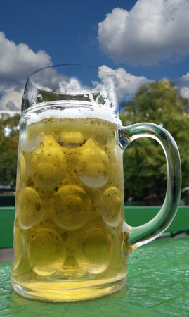 Full beer stein at an outdoor beer garden in Munich, Germany