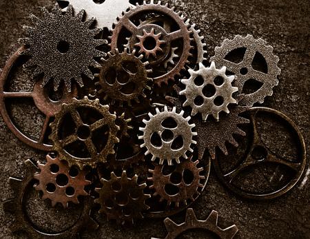 Assortment of  metal gears on grunge background Stockfoto