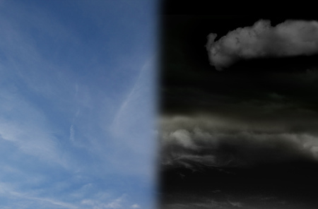 Split sky with blue on one half, dark storm clouds on the other Banco de Imagens