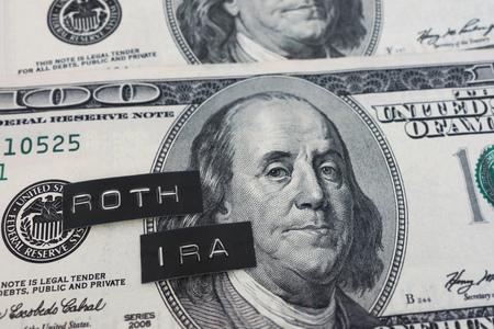 Roth IRA labels on hundred dollar bills Stock Photo - 101334446