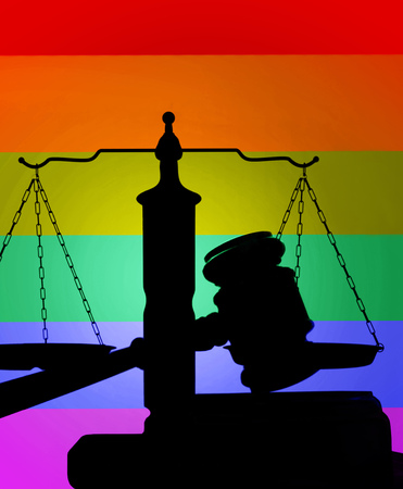 Court gavel and scales of justice with LGBTQ rainbow flag color background