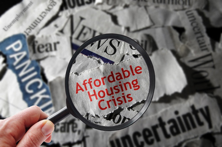 Affordable Housing Crisis newspaper headline and magnifying glass