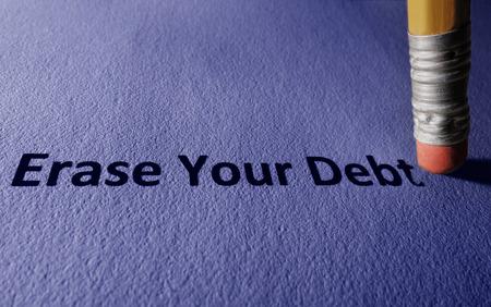 Pencil with Erase Your Debt text on paper Banco de Imagens