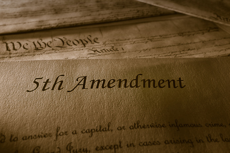 The 5th Amendment with US Constitution in the background Banco de Imagens