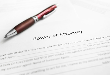 Power of Attorney legal document with pen